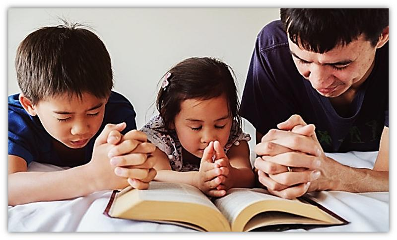 children and father praying